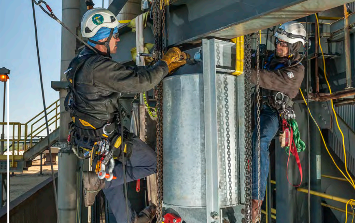 SPRAT certified rope access technicians retrofit pipe supports at height on an aging industrial energy facility.